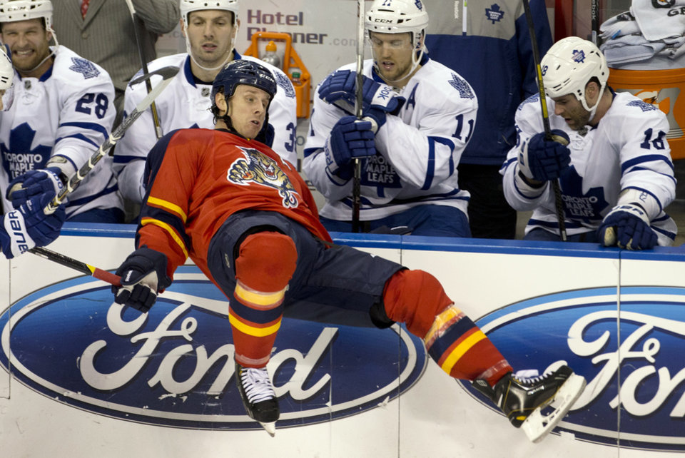 Photo - Florida Panthers' Stephen Weiss falls in front of the Toronto Maple Leafs bench during the first period of an NHL hockey game in Sunrise, Fla., Monday, Feb. 18, 2013.  (AP Photo/J Pat Carter)