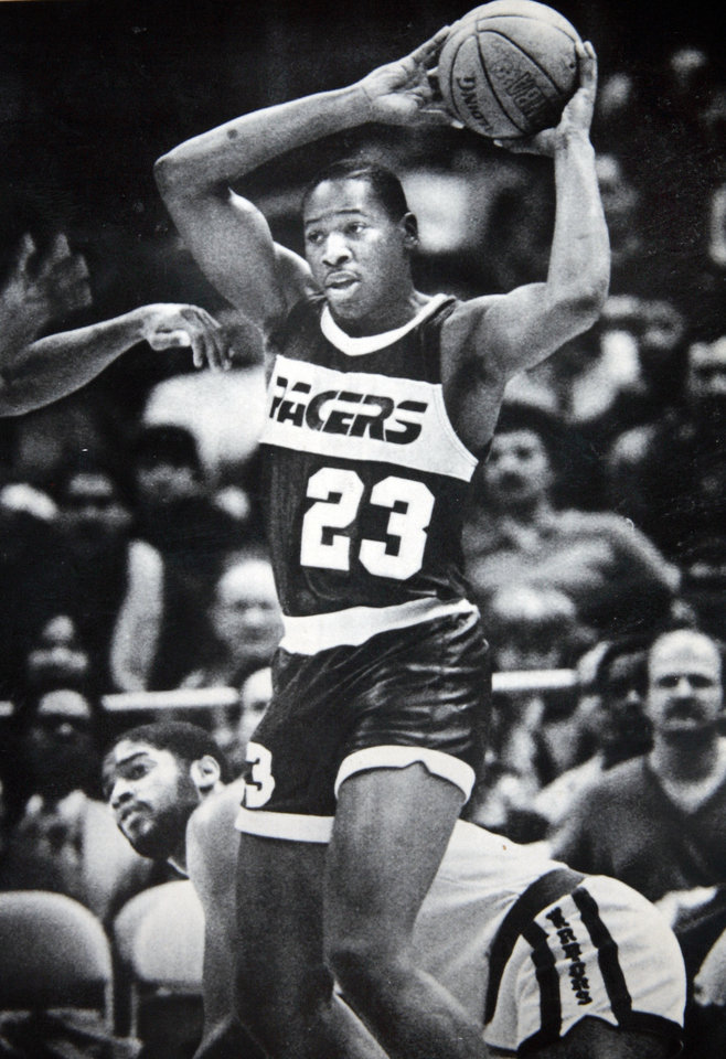 Former OU basketball player Wayman Tisdale. OAKLAND, Calif. Jan. 14--WON THE SCRAMBLE, BUT LOST THE GAME--Indiana Pacers rookie forward Wayman Tisdale (23) holds the ball over his head after collecting the loose ball in a scramble with Golden State Warriors center Joe Barry Carroll (behind) Tisdale ended up with 32 points, but the Warriors won the game 119-108. (AP Laserphoto) Photo taken 1/14/1986, Photo published 1/15/1986, 9/13/1988 in The Daily Oklahoman. ORG XMIT: KOD