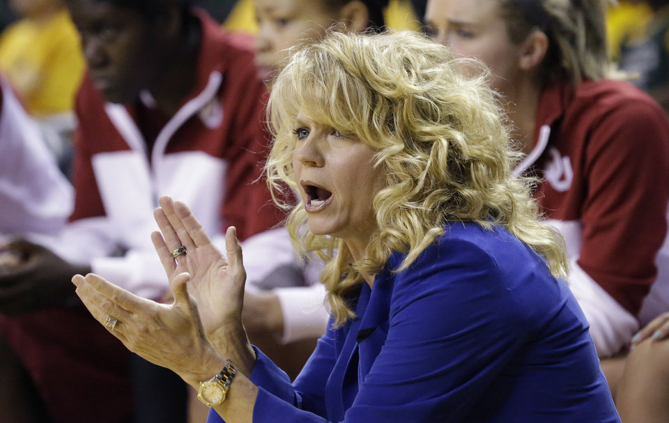 Photo - Oklahoma head coach Sherri Coale cheers her team on from the sideline during the first half of an NCAA college basketball game against Baylor, Monday, Feb. 24, 2014, in Waco, Texas. (AP Photo/LM Otero)