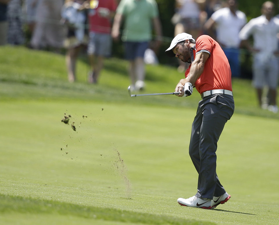 Photo - Paul Casey hits from the first fairway during the third round of the Memorial golf tournament Saturday, May 31, 2014, in Dublin, Ohio. (AP Photo/Darron Cummings)