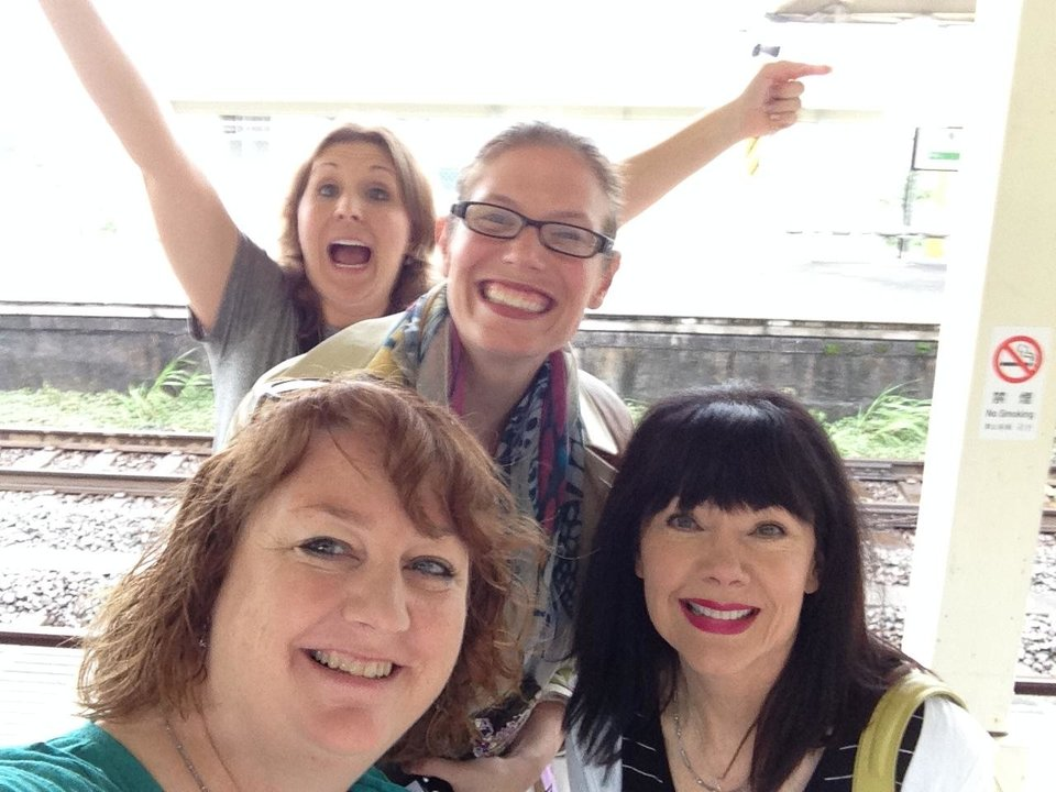 Photo -       Ellen Kraft, Calypso Gilstrap, Michelle Sutherlin and Jeannie Green-LaCroix waiting at the train station.