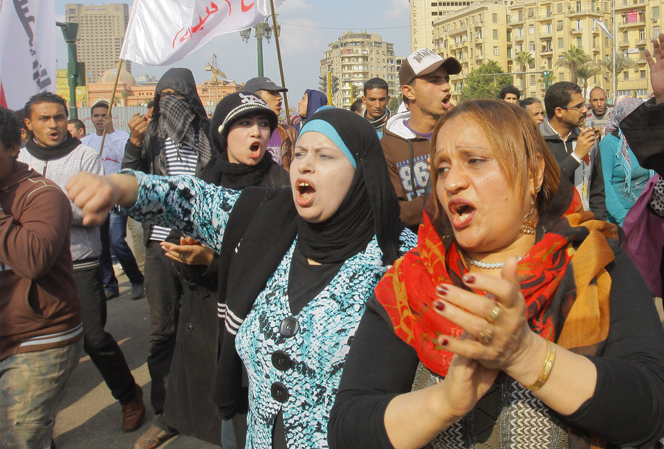 Photo - Egyptian women shout anti-Mohammed Morsi slogans during a protest in Tahrir Square, the focal point of Egyptian uprising, in Cairo, Egypt, Saturday, Dec. 29, 2012. Egypt's Islamist president warned Saturday against any unrest that could harm the drive to repair the country's battered economy in a sharply worded speech that urged the opposition to work with his government. Mohammed Morsi made the comments in his first speech to the newly convened upper house of parliament, which he said will have full legislative powers until a new lower house of parliament is elected next year.(AP Photo/Amr Nabil)