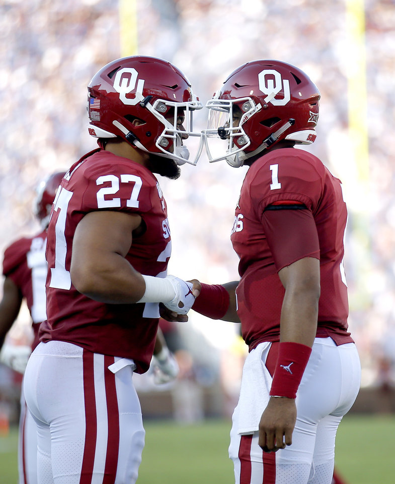 Photo - Oklahoma's Jeremiah Hall (27) and Jalen Hurts (1) celebrate a Hall touchdown in the second quarter during a college football game between the University of Oklahoma Sooners (OU) and the Houston Cougars at Gaylord Family-Oklahoma Memorial Stadium in Norman, Okla., Sunday, Sept. 1, 2019. [Sarah Phipps/The Oklahoman]