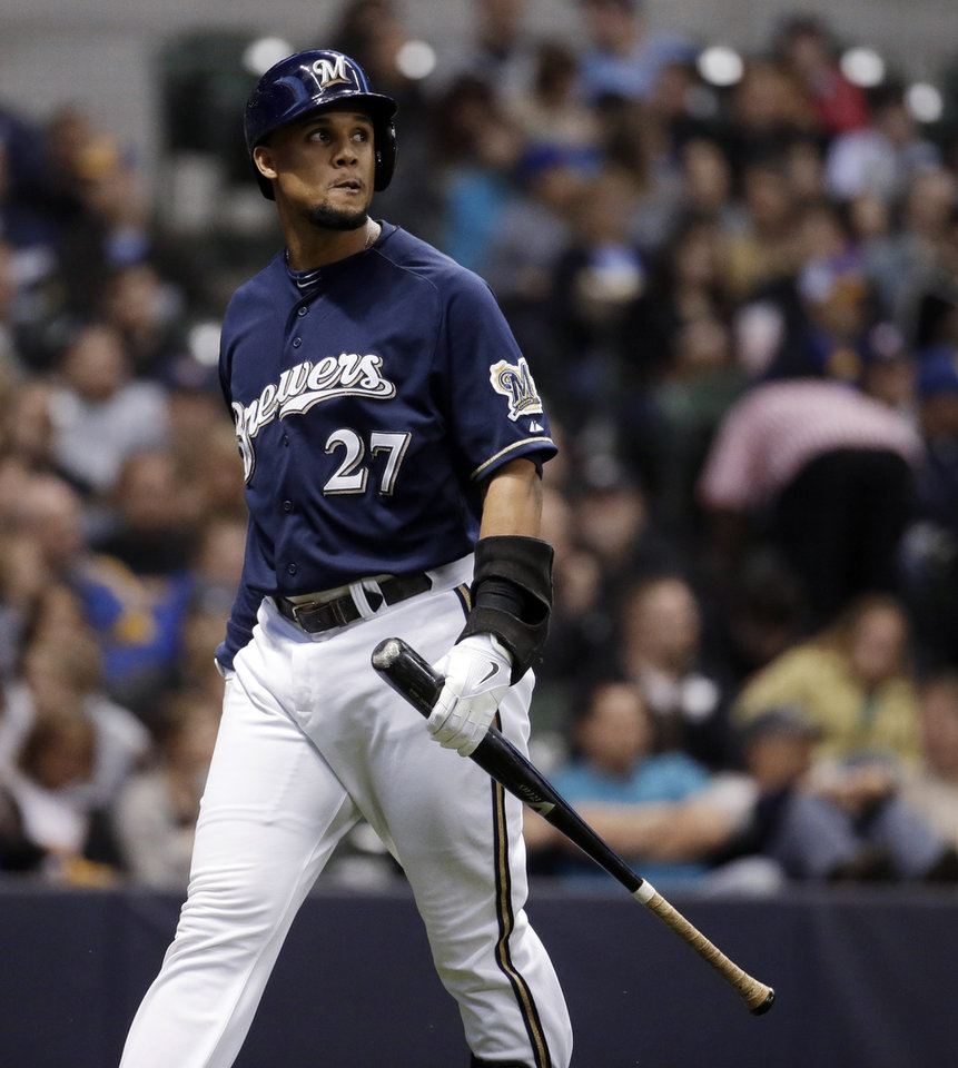 Photo - Milwaukee Brewers' Carlos Gomez walks back to the dugout after striking out during the first inning of a baseball game against the San Diego Padres on Tuesday, April 22, 2014, in Milwaukee. Gomez is appealing the three-game suspension he was given earlier in the day. (AP Photo/Morry Gash)