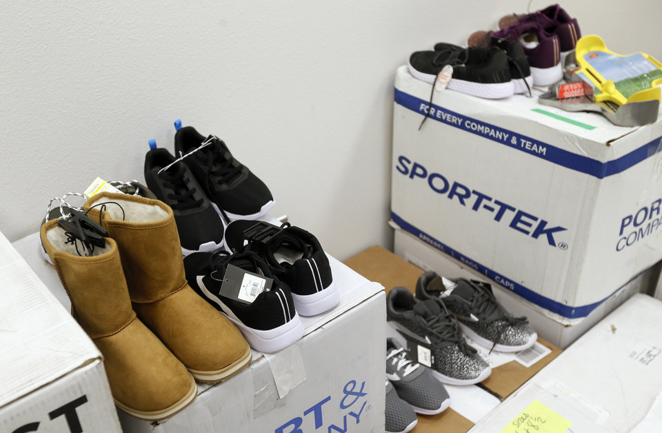 Photo - Shoes in the clothing closet at the new facility for Positive Tomorrows, a school for homeless children, at 901 N Villa in Oklahoma City, Tuesday, Nov. 26, 2019. [Nate Billings/The Oklahoman]