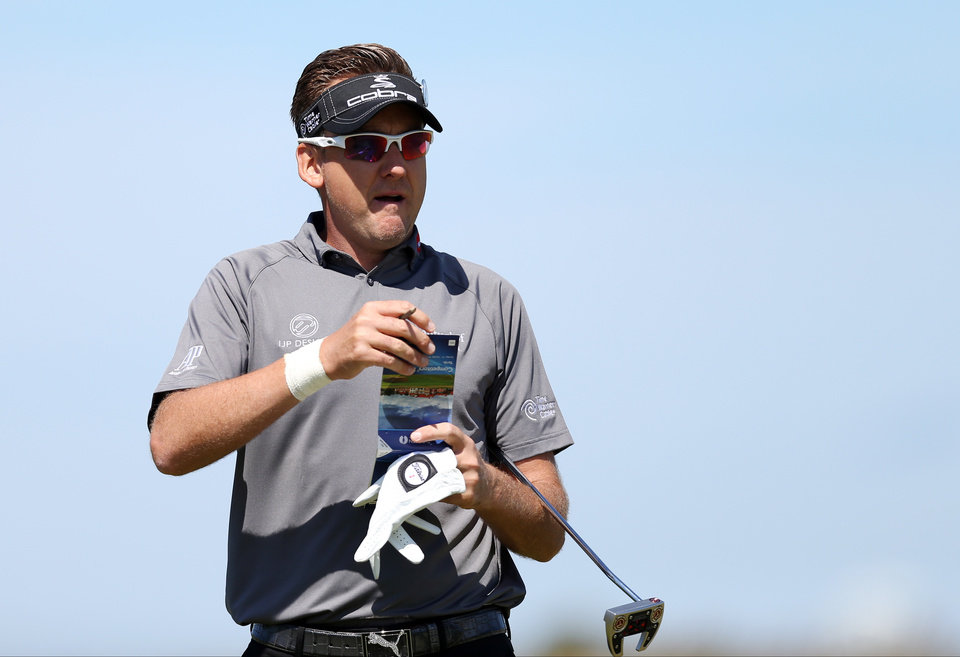 Photo - Ian Poulter of England prepares to putt on the 6th green during a practice round ahead of the British Open Golf championship at the Royal Liverpool golf club, Hoylake, England, Tuesday July 15, 2014. The British Open starts on Thursday July 17. (AP Photo/Scott Heppell)