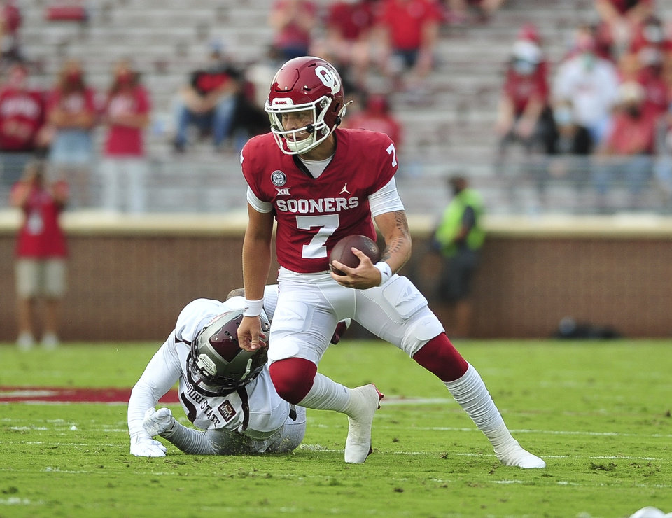 Photo - Oklahoma quarterback Spencer Rattler runs with the ball against Missouri State during an NCAA college football game Saturday, Sept. 12, 2020, in Norman, Okla. (Kyle Phillips/The Norman Transcript via AP)