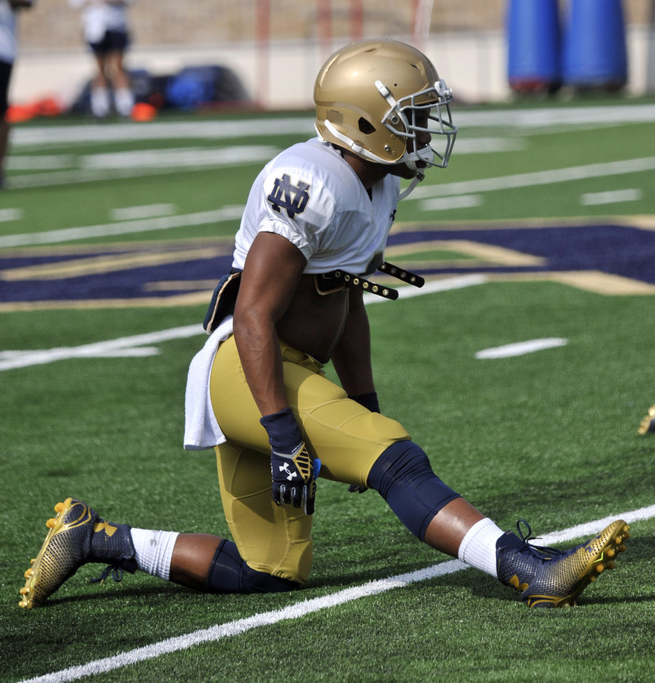 Photo - In this photo taken on Aug. 16, 2014, Notre Dame linebacker Cody Riggs stretches during NCAA college football practice in South Bend, Ind. (AP Photo/Joe Raymond, File)