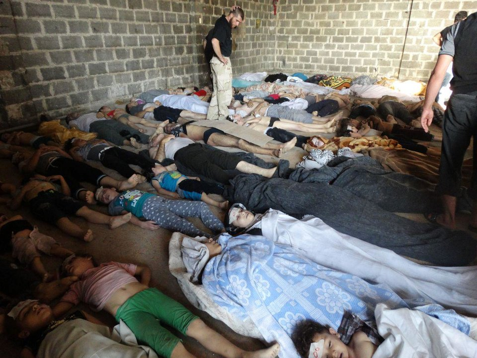 Photo - FILE - This image provided by Shaam News Network on Thursday, Aug. 22, 2013,  which has been authenticated based on its contents and other AP reporting, purports to show dead bodies after an attack on Ghouta, Syria on Wednesday, Aug. 21, 2013. The early-morning barrage against rebel-held areas around the the Syrian capital Damascus immediately seemed different: The rockets made a strange, whistling noise. Seconds after one hit near his home, Qusai Zakarya says he couldn't breathe, and he desperately punched himself in the chest to get air. Hundreds of suffocating, twitching victims flooded into hospitals. Others were later found dead in their homes, towels still on their faces from their last moments trying to protect themselves from gas. Doctors and survivors recount scenes of horror from the alleged chemical attack a week ago. (AP Photo/Shaam News Network, File)