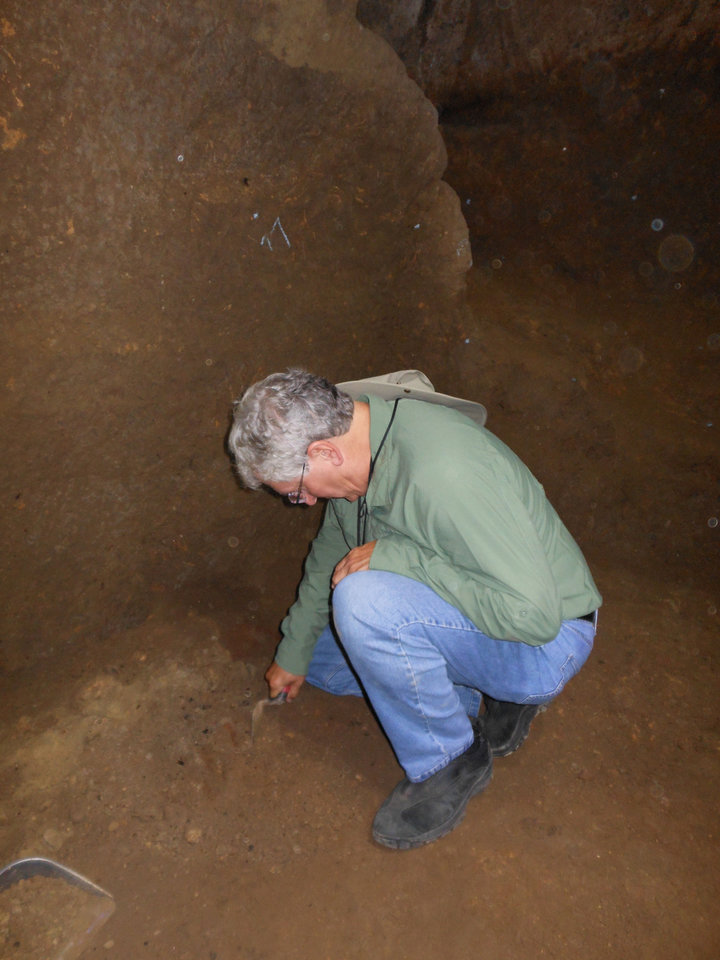 Photo - OCU President Robert Henry digging in Etruscan cave. PHOTO PROVIDED