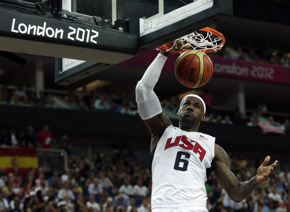 Photo - United States' LeBron James dunks during the men's gold medal basketball game against Spain at the 2012 Summer Olympics, Sunday, Aug. 12, 2012, in London. (AP Photo/Charles Krupa)