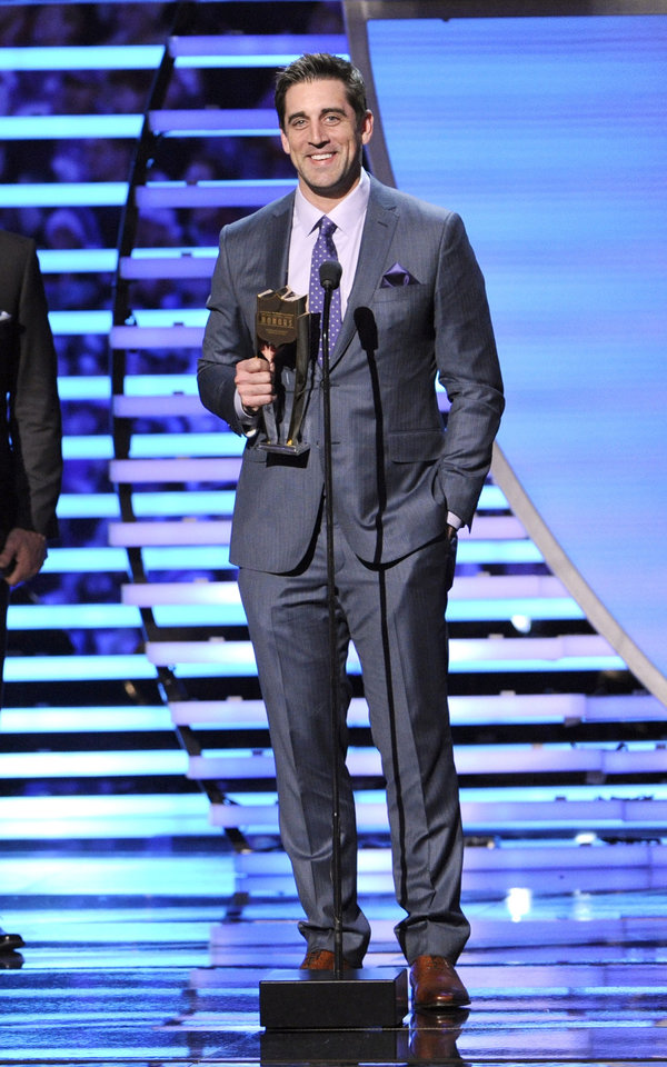 Photo - Aaron Rodgers of the Green Bay Packers accepts his award for the Never Say Never Moment of the Year award at the third annual NFL Honors at Radio City Music Hall on Saturday, Feb. 1, 2014, in New York. (Photo by Evan Agostini/Invision for NFL/AP Images)
