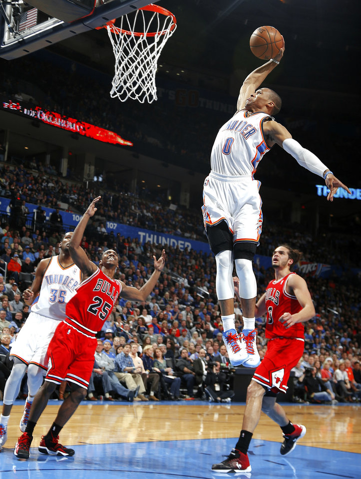 Oklahoma City\'s Russell Westbrook dunks the ball during the NBA game between the Oklahoma City Thunder and the Chicago Bulls, Sunday, Feb. 24, 2013, at the Chesapeake Energy Arena in Oklahoma City. Photo by Sarah Phipps, The Oklahoman