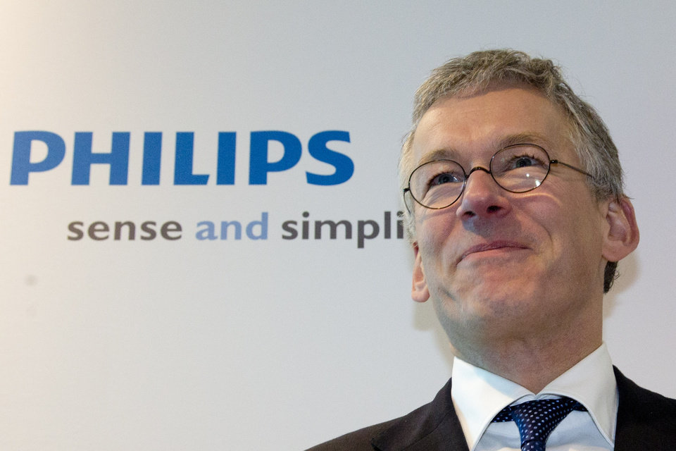 Photo - Philips CEO Frans van Houten smiles as he poses for photographers when arriving for a press conference in Amsterdam, Netherlands, Tuesday Jan. 29, 2013. Royal Philips Electronics NV Tuesday said it will sell the entertainment division which contains many of the consumer products for which it is best known, such as audio and video equipment, to Funai Electric Co., Ltd., of Japan for Euros 150 million (USD 202 million) plus licensing fees. Funai will assume responsibility for the manufacturing of the Philips products but license and sell them under the Philips brand for five years. It has an option to renew. (AP Photo/Peter Dejong)