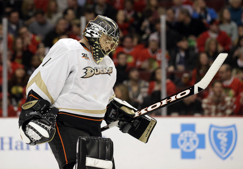 Photo - Anaheim Ducks goalie Jonas Hiller looks down as he skates to the bench during the second period of an NHL hockey game against the Chicago Blackhawks in Chicago, Friday, Jan. 17, 2014. (AP Photo/Nam Y. Huh)