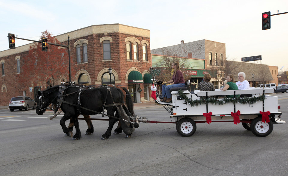 Wendy Meyer drives a team of horses in downtown Edmond on  Thursday. Photo by Sarah Phipps, The Oklahoman <strong>SARAH PHIPPS - SARAH PHIPPS</strong>
