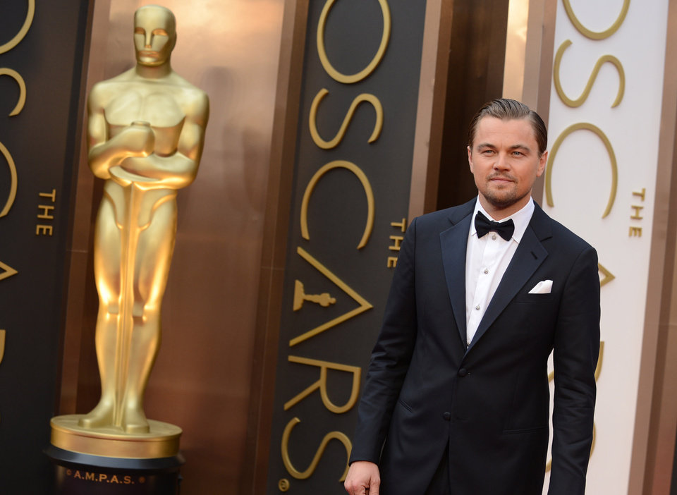 Photo - Leonardo DiCaprio arrives at the Oscars on Sunday, March 2, 2014, at the Dolby Theatre in Los Angeles.  (Photo by Jordan Strauss/Invision/AP)