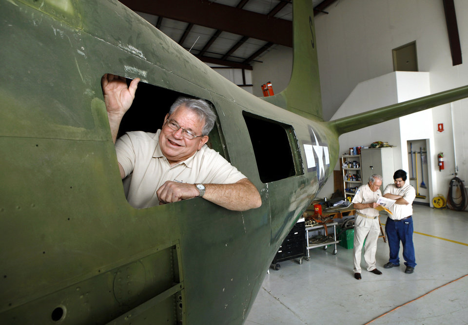 Tom Parsons looks out of an opening in the side of the aircraft.  Parsons is maintenance officer for the project. A group of men are restoring the bomber inside a hangar at Guthrie Municipal Airport.    Photo by Jim Beckel, The Oklahoman <strong>Jim Beckel - THE OKLAHOMAN</strong>