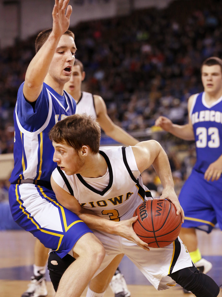 Photo - Kiowa's Clay Doyle tries to pass the ball around Glencoe defender Ty Lazenby  during Class A boys high school basketball championship game in the Jim Norick Arena at State Fair Park on  Saturday, March 8, 2014. Glencoe defeated Kiowa, 57-39. Photo by Jim Beckel, The Oklahoman