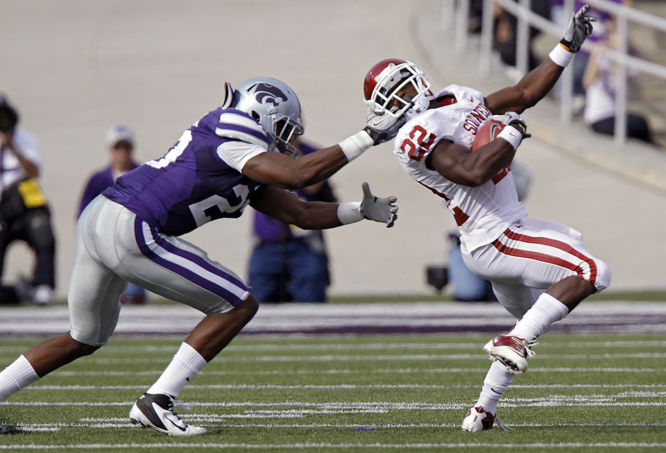 Kansas State Wildcats' Emmanuel Lamur (23) pulls the face mask of Oklahoma Sooners' Roy Finch (22) during the college football game between the University of Oklahoma Sooners (OU) and the Kansas State University Wildcats (KSU) at Bill Snyder Family Stadium on Saturday, Oct. 29, 2011. in Manhattan, Kan. Photo by Chris Landsberger, The Oklahoman