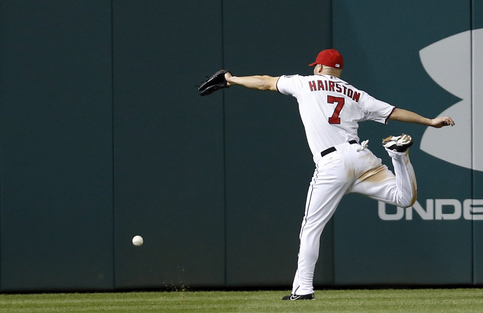 Photo - Washington Nationals left fielder Scott Hairston can't grab  a ball hit for an RBI double by New York Mets' Eric Young Jr. during the fifth inning of a baseball game at Nationals Park Friday, May 16, 2014, in Washington. (AP Photo/Alex Brandon)