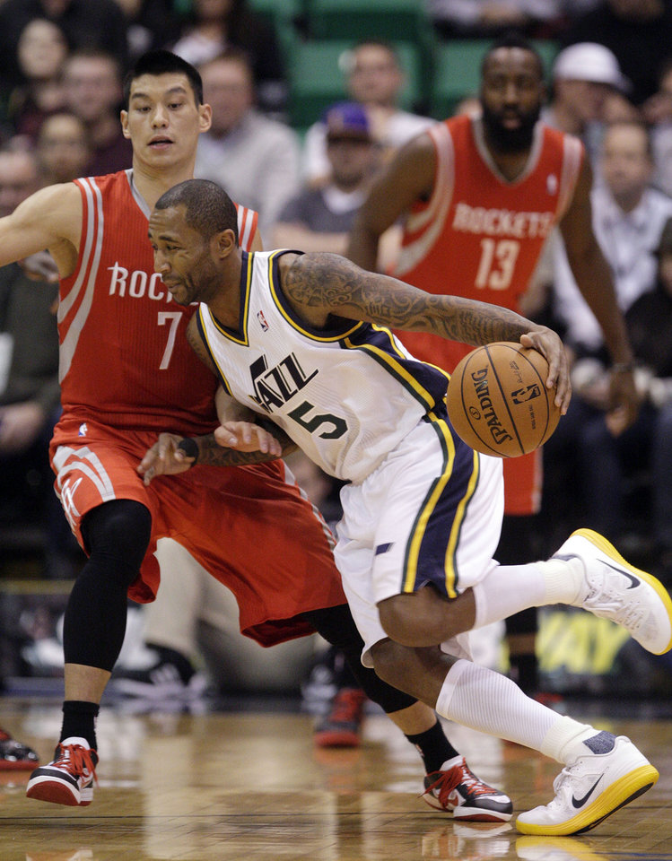 Utah Jazz guard Mo Williams (5) drives around Houston Rockets guard Jeremy Lin (7) in the first quarter during an NBA basketball game Monday. Nov. 19, 2012, in Salt Lake City. (AP Photo/Rick Bowmer)
