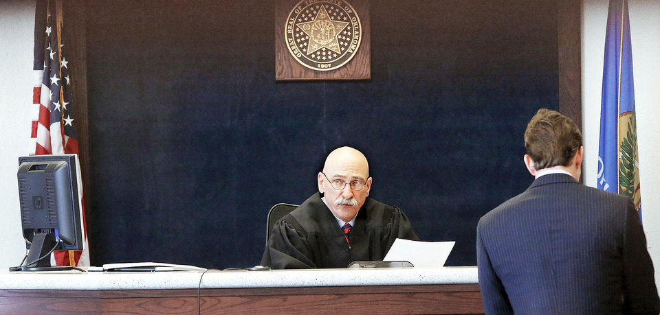Photo - Payne County Special District Judge R.L. Hert Jr. presides over a video arraignment for Oklahoma State University student Nathan Cochran. Cochran, not shown, faces sexual battery charges in connection with reports of sexual assaults.  Photo by Jim Beckel, The Oklahoman