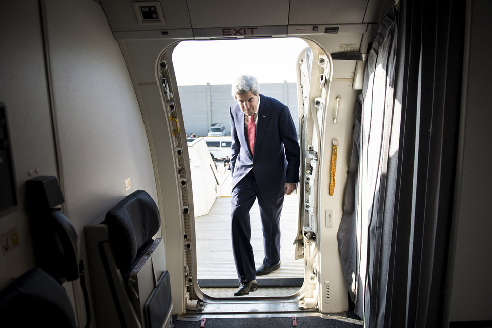 Photo - U.S. Secretary of State John Kerry boards his plane at Ben Gurion International Airport as he heads to Jordan, in Tel Aviv, Israel, Sunday, Jan. 5, 2014. Kerry is heading to Jordan and Saudi Arabia to discuss his effort to broker peace between Israel and the Palestinians, yet his conversations with the U.S. allies will undoubtedly turn to other Mideast trouble spots. Kerry said Saturday that progress is being made in the Israeli-Palestinian talks, yet key hurdles are yet to be overcome. (AP Photo/Brendan Smialowski, Pool)