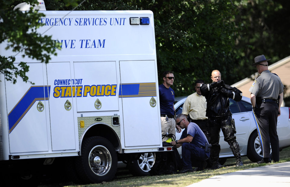 Photo - Connecticut State Police Dive Team search Pine Lake, for a second day,  in Bristol, Conn., the hometown of the former New England Patriots player Aaron Hernandez,  Tuesday, July 30, 2013. Authorities have declined to comment on the search except to confirm it is related to the Hernandez investigation.  Hernandez has pleaded not guilty to murder in the death of Odin Lloyd, a 27-year-old Boston semi-professional football player. (AP Photo/Jessica Hill)