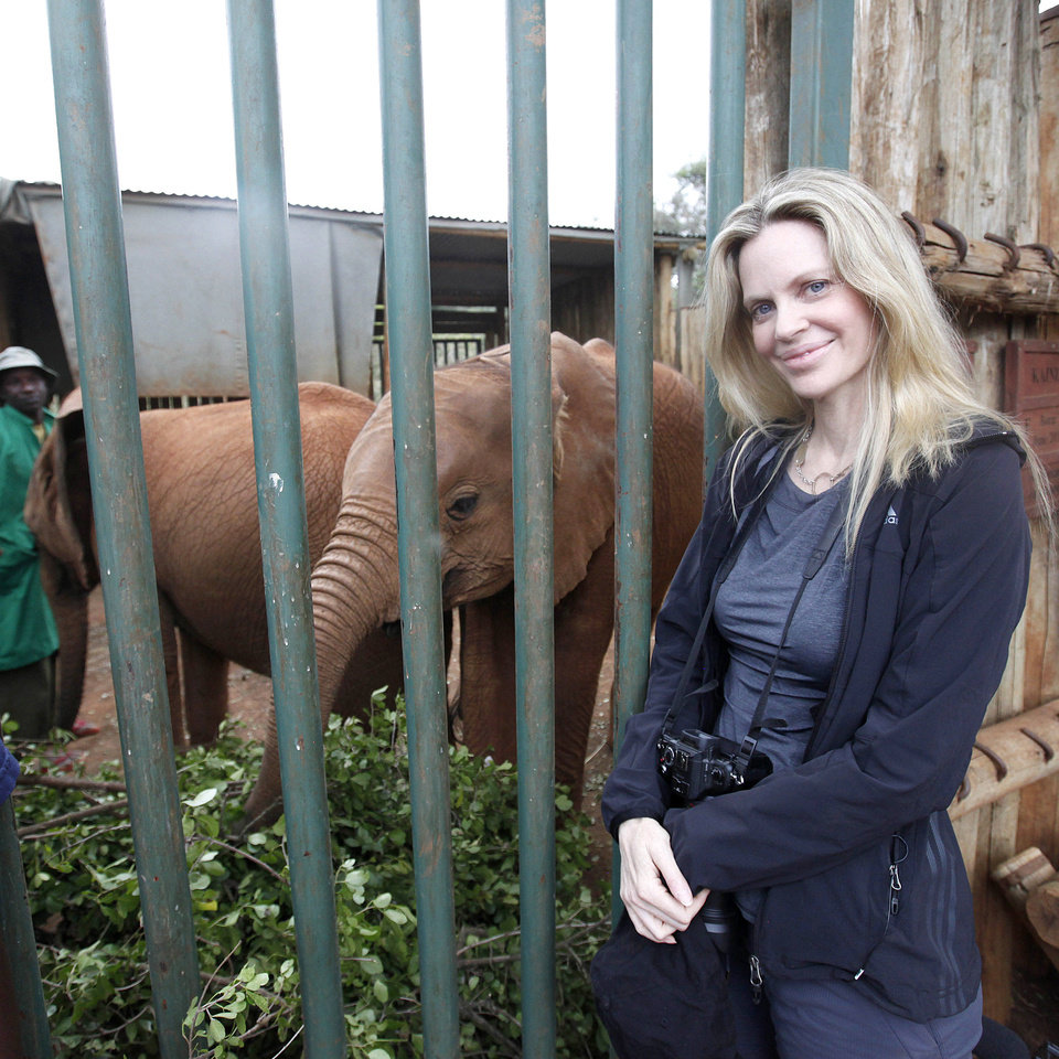 US actress Kristin Bauer van Straten visits the David Sheldrick Elephant Orphanage in Nairobi, Kenya, Saturday, Aug. 25, 2012. Bauer is a celebrity patron of the International Fund for Animal Welfare, IFAW, and is in Kenya to make a documentary that will highlight the threat to elephants and rhinos. (AP Photo/Sayyid Azim)