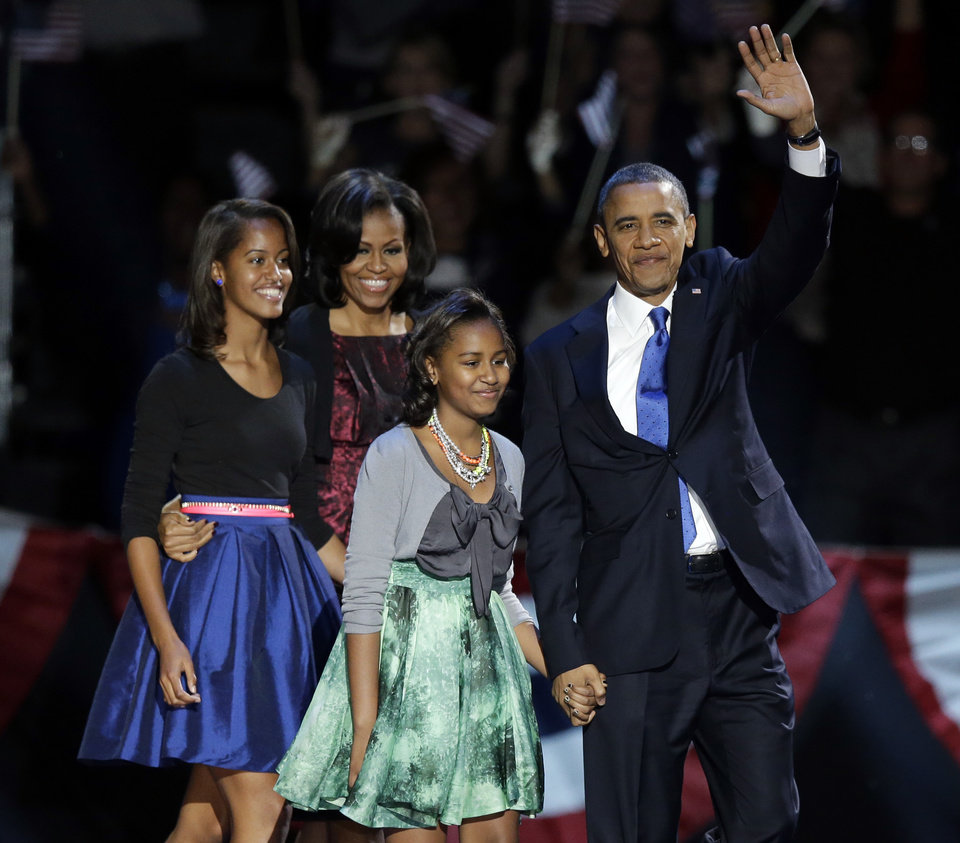 Photo -   President Barack Obama waves as he walks on stage with first lady Michelle Obama and daughters Malia and Sasha at his election night party Wednesday, Nov. 7, 2012, in Chicago. President Obama defeated Republican challenger former Massachusetts Gov. Mitt Romney.(AP Photo/Chris Carlson)