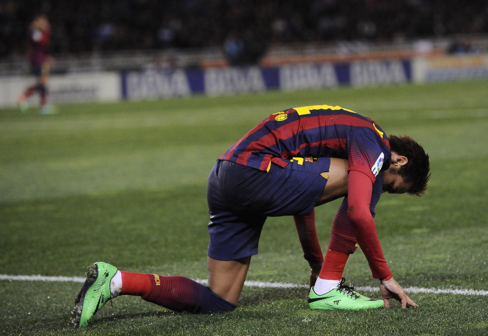 Photo - FC Barcelona's Neymar da Silva of Brazil, kneels on the pitch at the end of the match against Real Sociedad, during their Spanish League soccer match, at Anoeta  stadium in San Sebastian, Spain, Saturday, Feb. 22, 2014. FC Barcelona lost the match 3-1. (AP Photo/Alvaro Barrientos)