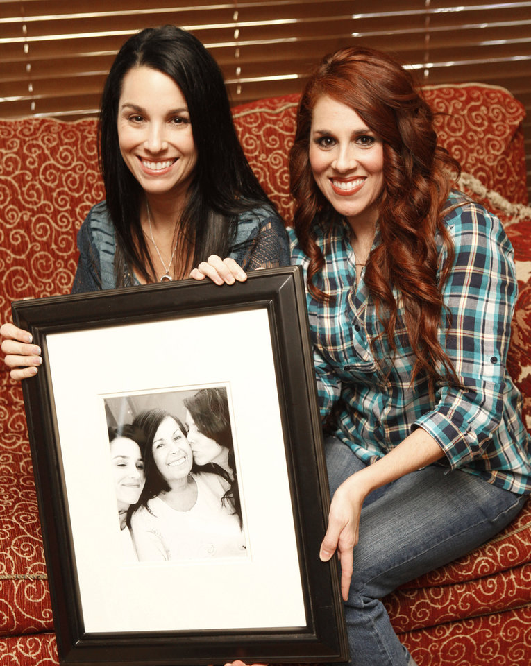 Stacey Holden, left, and her sister Wendy Shepherd hold a photo of their mom, Judy Werber, at Wendy's home in Edmond.  By Paul Hellstern, The Oklahoman <strong>PAUL HELLSTERN - Oklahoman</strong>