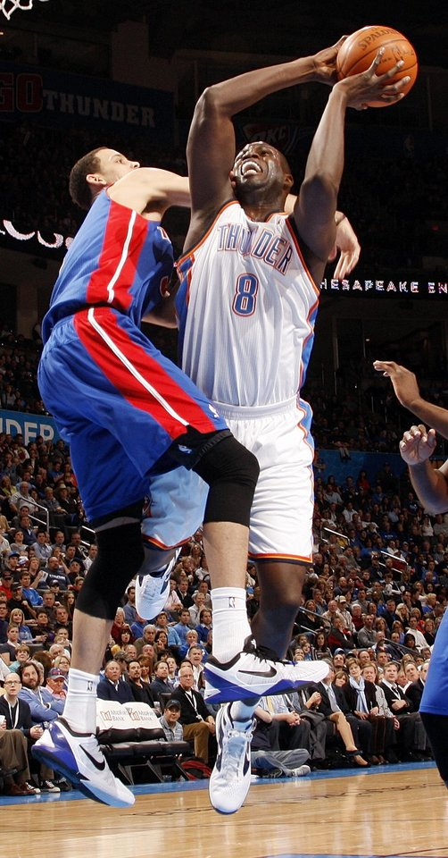 Detroit's Austin Daye (5) fouls Oklahoma City's Nazr Mohammed (8) during the NBA basketball game between the Detroit Pistons and Oklahoma City Thunder at the Chesapeake Energy Arena in Oklahoma City, Monday, Jan. 23, 2012. Photo by Nate Billings, The Oklahoman