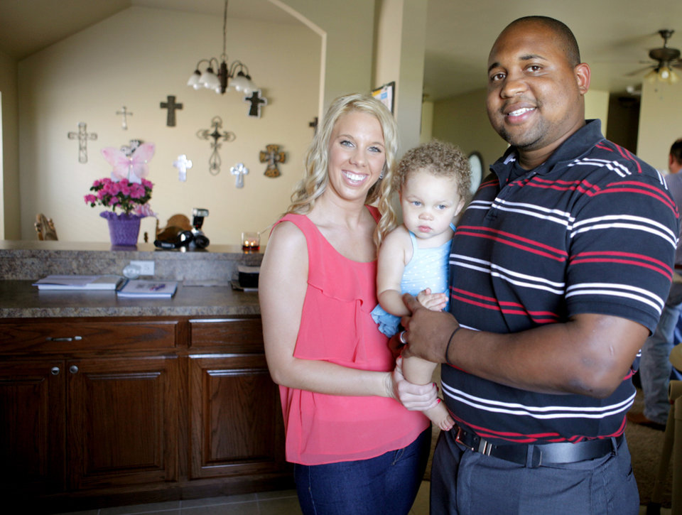 Jeremiah and Kayleen Burton pose for a photo with their daughter Jada inside their new home in Oklahoma City, Tuesday, June 26, 2012. The Burtons bought their home through the OHFA Advantage program. Photo by Bryan Terry, The Oklahoman