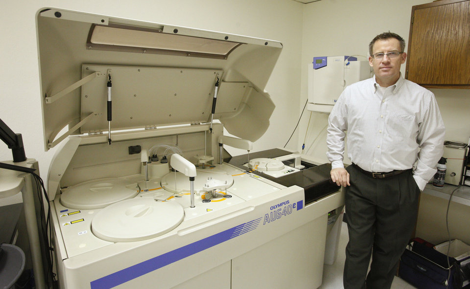 Jim Tedrow, president of Compliance Resource Group, stands by a machine, which lab technicians use to run some 375 drug and alcohol tests a day. Photo by Paul B. Southerland <strong>PAUL B. SOUTHERLAND</strong>