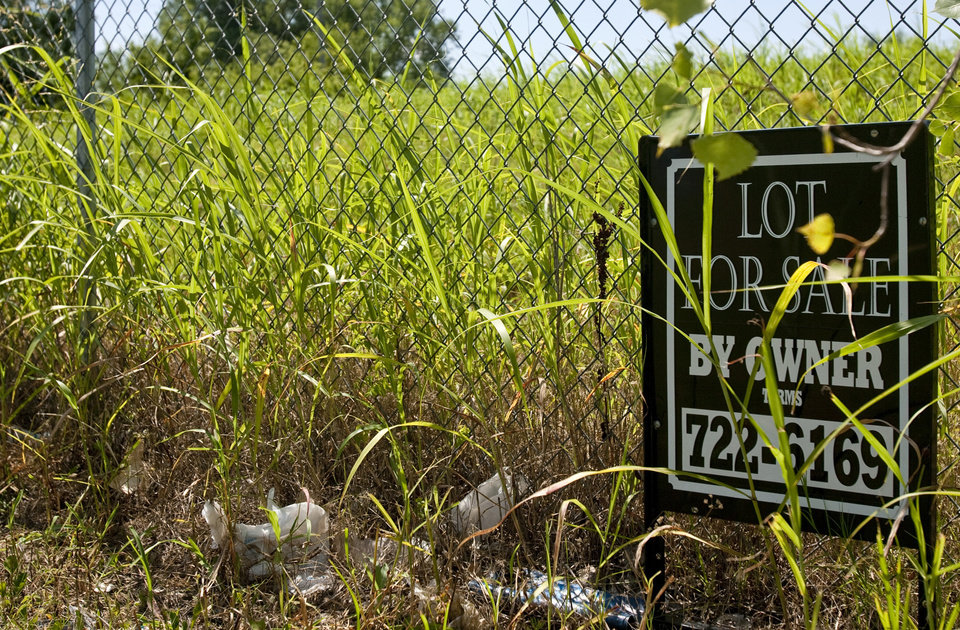 "A ""For Sale"" sign sits by the fence along side ""Ristricted Area"" signs at the Superfund site on NW 10th street in Oklahoma City, Okla on Tuesday June 20, 2010. Photo by Mitchell Alcala, The Oklahoman  ORG XMIT: KOD"