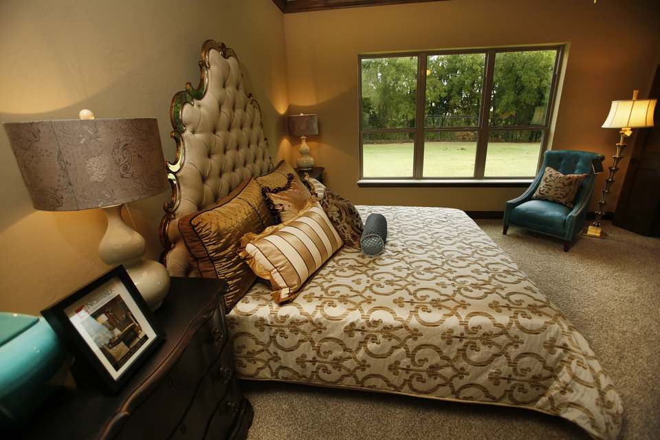 This view shows the master bedroom of a Parade of Homes entry by Johnston Builders at 12508 Deep Wood Creek Drive. Photo by Steve Gooch, The Oklahoman