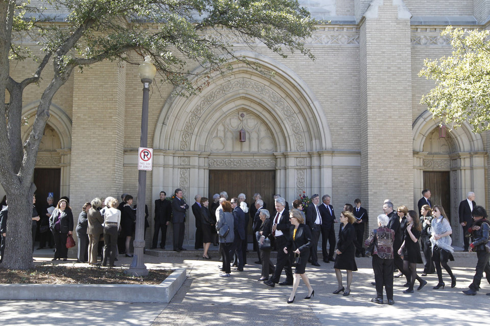 Choir members and early arrivals wait for Broadway Baptist Church to open for the funeral service of Van Cliburn in Fort Worth, Texas on Sunday, March 3, 2013. About 1,400 people attended a memorial service for Cliburn, who died Wednesday at 78 after fighting bone cancer. As the service began, the Fort Worth Symphony Orchestra accompanied a choir as pall bearers carried his flower-covered coffin into the Fort Worth church. (AP Photo/Star-Telegram, Ron T. Ennis, Pool)