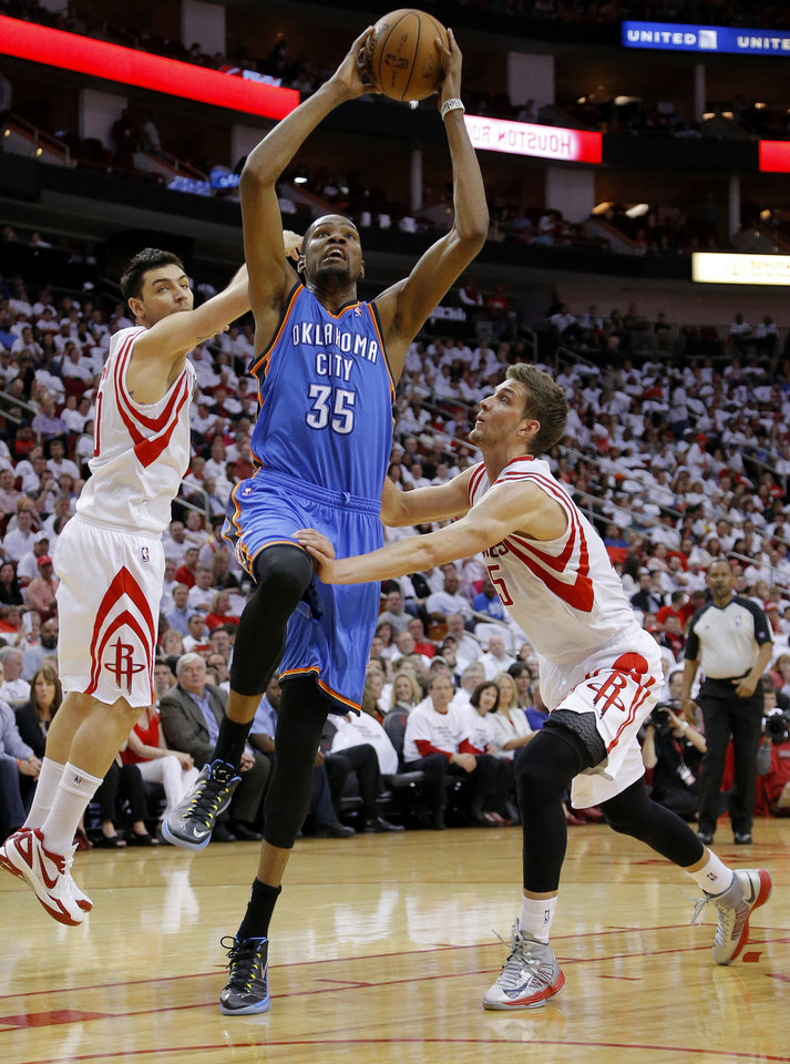 Oklahoma City\'s Kevin Durant (35) goes to the basket between Houston\'s Carlos Delfino (10) and Chandler Parsons (25) during Game 3 in the first round of the NBA playoffs between the Oklahoma City Thunder and the Houston Rockets at the Toyota Center in Houston, Texas, Sat., April 27, 2013. Photo by Bryan Terry, The Oklahoman