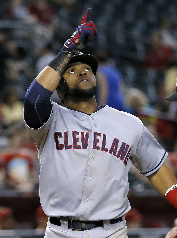 Photo - Cleveland Indians' Carlos Santana points upward after hitting a two-run home run against the Arizona Diamondbacks during the 11th inning of a baseball game, Tuesday, June 24, 2014, in Phoenix. (AP Photo/Matt York)
