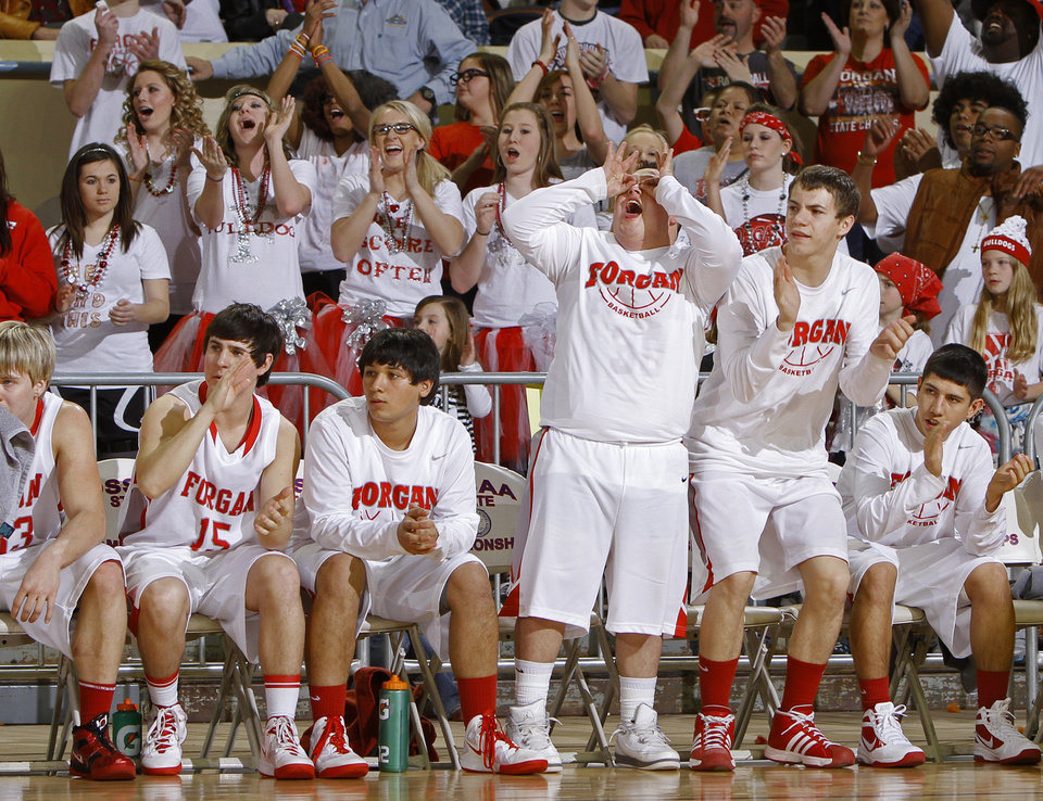 Photo - The Forgan bench reacts after a basket against Lomega during the semifinal game of the Class B boys state basketball tournament at State Fair Arena in Oklahoma CIty, Friday, March 3, 2012. Photo by Bryan Terry, The Oklahoman