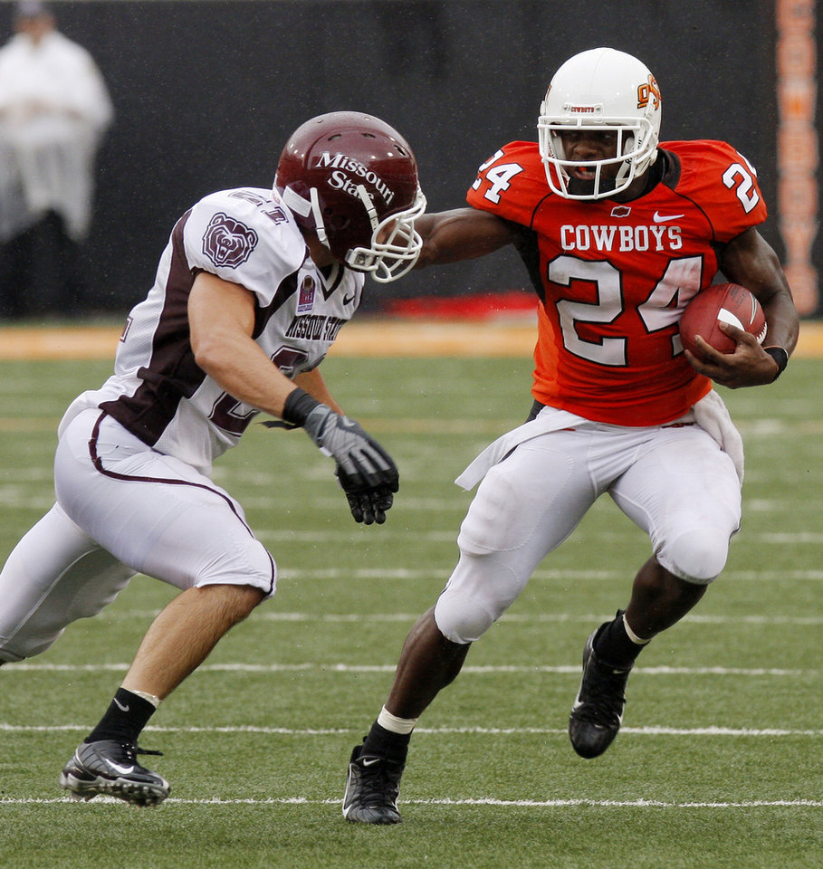 Photo - Kendall Hunter tries to avoid Skylar Smith at the Oklahoma State University (OSU) college football game against Missouri State University (MSU) Saturday Sept. 13, 2008 at Boone Pickens Stadium in Stillwater, Okla. BY DOUG HOKE, THE OKLAHOMAN. ORG XMIT: KOD