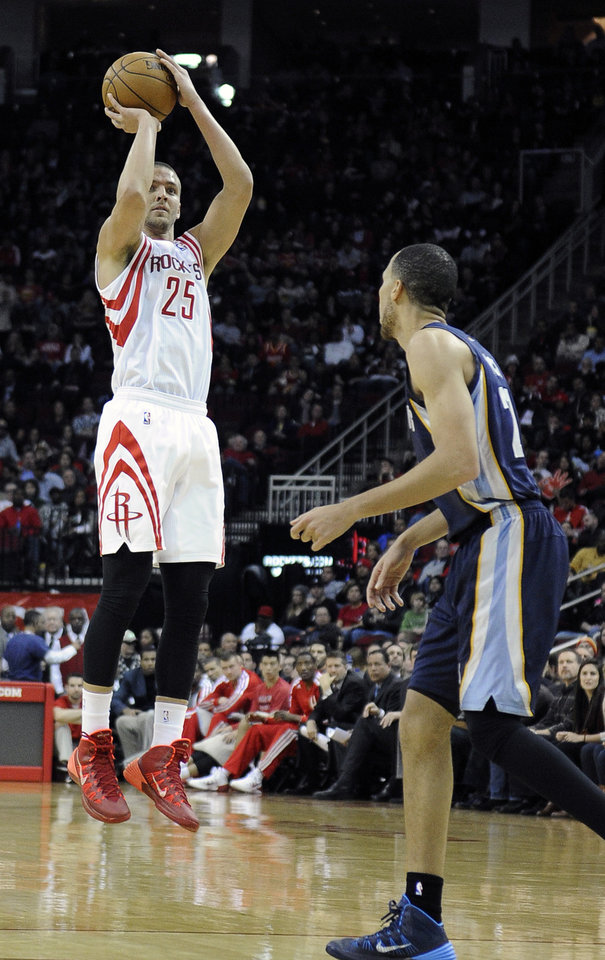 Photo - Houston Rockets' Chandler Parsons (25) shoots for one of the 10 three-point shots he made in the second half as Memphis Grizzlies' Tayshaun Prince watches during an NBA basketball game Friday, Jan. 24, 2014, in Houston. The Grizzlies won 88-87. (AP Photo/Pat Sullivan)