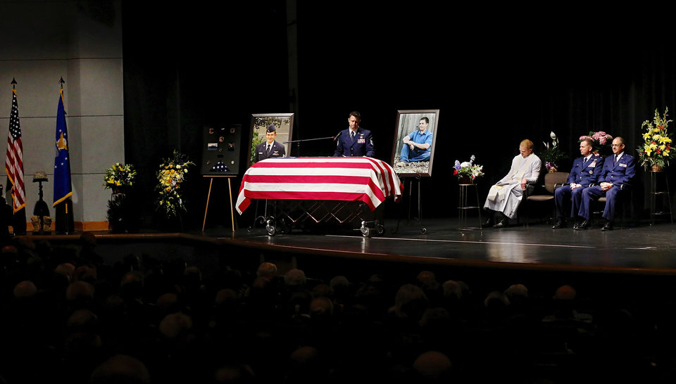 Friend and fellow airman, MSgt. Chris Charpentier delivers one of three eulogies for Fannin. More than 1,700 people, many of whom were dressed in the US Air Force's  dark blue service dress uniform, filled the lower and upper levels of the Rose State College Performing Arts Center Monday morning, May, 13, 2013, to attend a memorial service for SSgt. Daniel N. Fannin, a brother in arms killed April 27 in a plane crash while on a mission in Afghanistan.  Fannin , 30, was assigned to the 552nd Operations Support Squadron at Tinker Air Force base. He joined the Air Force in 2001. Photo  by Jim Beckel, The Oklahoman.