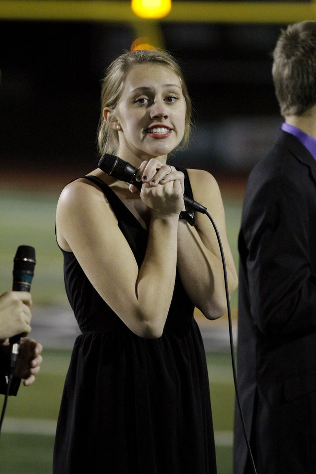 Photo - Norman North  Jazz Choir member Callie Cabbiness tries to stay warm before the group sings the National Anthem as her Timberwolves play Broken Arrow in class 6A football on Friday, Nov. 16, 2012 in Norman, Okla.  Photo by Steve Sisney, The Oklahoman