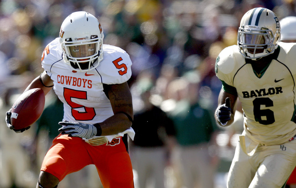 Photo - OSU's Keith Toston (5) runs up field as he is chased by Baylor's Antonio Jones (6) during the college football game between Baylor University and Oklahoma State University (OSU) at Floyd Casey Stadium in Waco, Texas, Saturday, Oct. 24, 2009.  Photo by Sarah Phipps, The Oklahoman