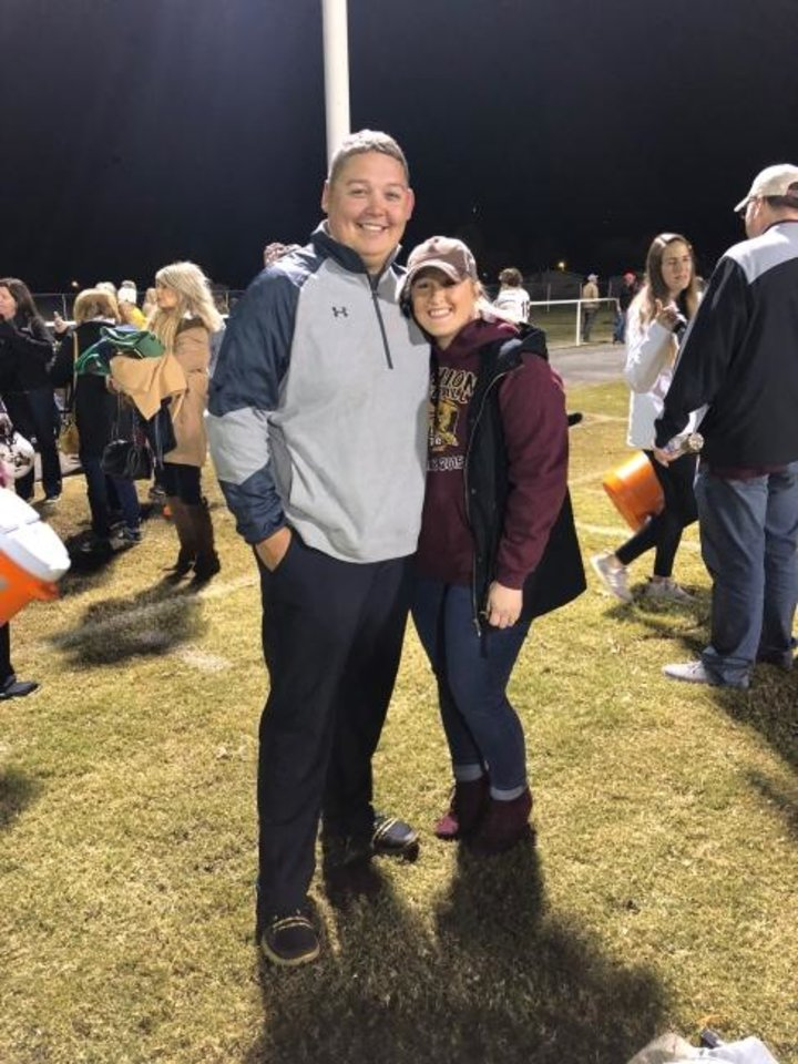 Photo -  Cashion assistant coach Cale Cochran, left, with his wife, Jacie, after a Cashion football game. Jacie died during childbirth on July 2. [Photo provided]