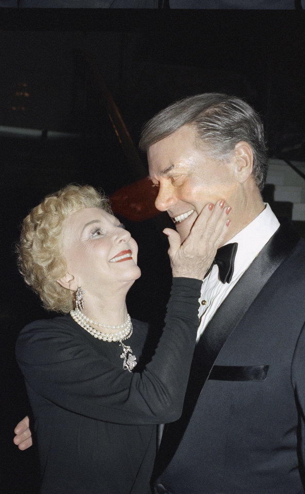 Photo -   FILE - In this Sunday, Feb. 3, 1986 file photo, actress Mary Martin touches the cheek of her son, Larry Hagman, also a famous actor, at the after-theater party for