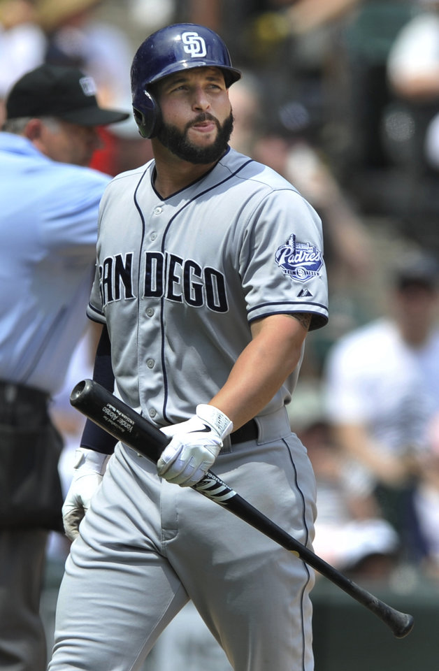 Photo - San Diego Padres' Yonder Alonso reacts to striking out during the fifth inning of an inter league baseball game against the Chicago White Sox in Chicago, Sunday, June 1, 2014. Chicago won 4-1. (AP Photo/Paul Beaty)